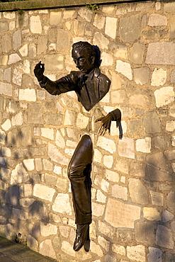 Sculpture of Le Passe Muraille (The Passer Through Walls)  by Jean Marais, Montmartre, Paris, France, Europe
