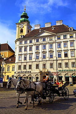 Horse drawn carriage in Freyung Square, Vienna, Austria, Europe