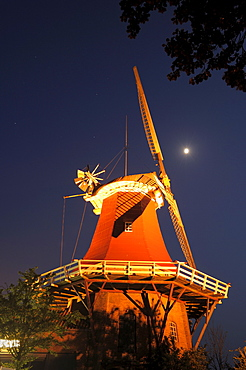 Windmill, Greetsiel at night, Lower Saxony, Germany / full moon