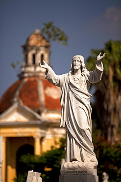 Jesus statue on a grave of latin americas biggest Cemetery Cementerio Cristobal Colon in Havana, Cuba, Caribbean / Havanna