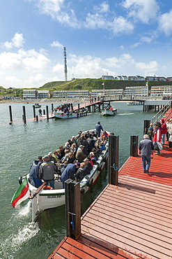 Open boat with tourists, Heligoland, Schleswig-Holstein, Germany