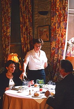 Guests and waitress in restaurant, Dijon, Cote d'Or, Burgundy, France