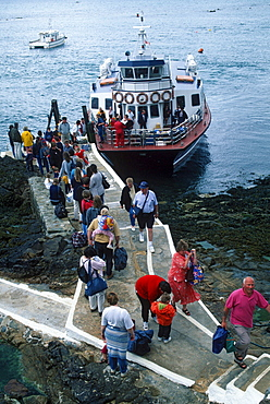 Passengers at landing stage of ferry boat, Herm, Channel Islands, Great Britain