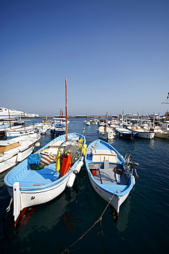 Fishing boats and ferry in harbour, Capri, Campania, Italy, Europe