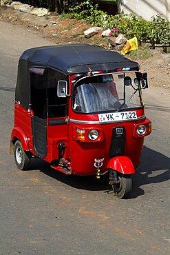 Red tuk-tuk, Matale, Sri Lanka, Asia