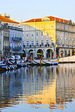 Moliceiros moored along the main canal at sunset, Aveiro, Venice of Portugal, Beira Littoral, Portugal, Europe