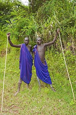 Two Surma men with scarification, Tulgit, Omo River Valley, Ethiopia, Africa
