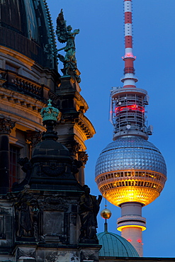 Close-up of the Berliner Dom (Cathedral) with the Television Tower in the background at night, Berlin, Germany, Europe