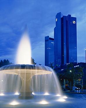 The Deutsche Bank with water fountain illuminated at dusk, Frankfurt am Main, Germany, Europe