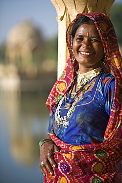 Portrait of a mid adult woman in traditional dress, Jaisalmer, Rajasthan, India, Asia