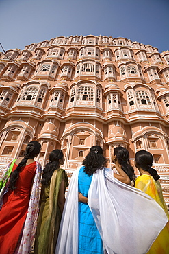 Women in traditional dress standing in front of the Palace of the Winds (Hawa Mahal), Jaipur, Rajasthan, India, Asia