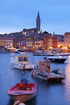 Ships and boats in the harbour and the old town with cathedral of St. Euphemia at dusk, Rovinj, Istria, Croatia, Europe