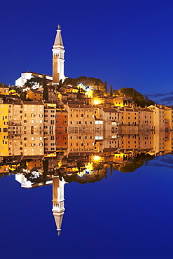 Old town with cathedral of St. Euphemia reflecting in the water at night, Istria, Croatia, Europe