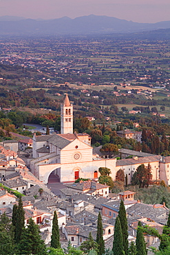 View over Assisi to Santa Chiara Basilica at sunset, Assisi, Perugia District, Umbria, Italy, Europe