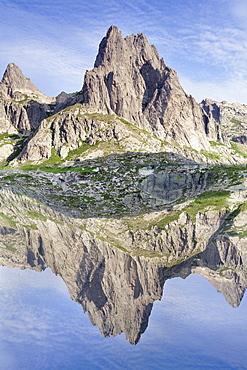 Pic Lombarduccio reflecting in Lac de Melo, Gorges de la Restonica, Haute Corse, Corsica, France, Mediterranean, Europe