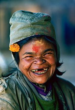 A holy woman laughing at Pashupatinath Hindu Temple in Nepal