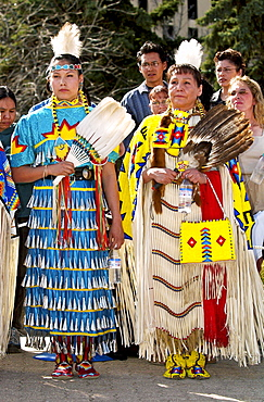 Cree Indian women, First Nation Canadian, in traditional costume with face painted at heritage display in Regina, Canada