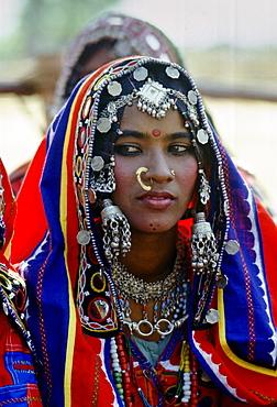 Young girl in national costume and jewels, Devara Yamzal, India.
