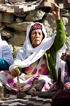 Woman spins wool in mountain village of Altit in Hunza region of Karokoram Mountains, Pakistan