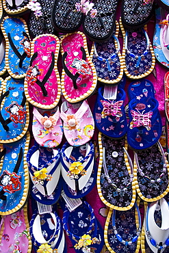 Shoes for sale in a Bangkok market, Thailand