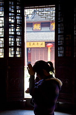 Worshipper praying at the Jade Buddha Temple, Shanghai, China