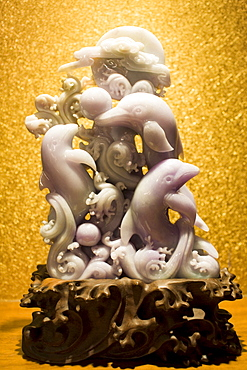 Lavender jade dolphins ornament on display in the Huahui Jade Factory and Showroom, Xian, China