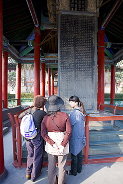 Visitors look at the Forest of Stone Tablets, also known as the Forest of Stelae, Xian, China