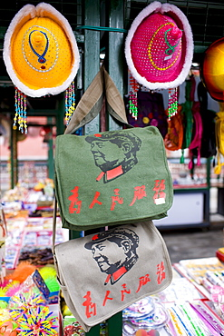 Souvenir stall selling bags printed with portraits of Chairman Mao, Beijing, China