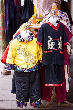 Chinese silk clothes souvenirs on sale near Dazu rock carvings, Mount Baoding, near Chongqing, China