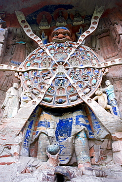 Anicca, God of Destiny holds wheel of life of Buddhist karma, Dazu rock carvings, Mount Baoding, China
