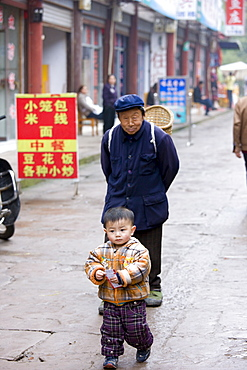 Grandfather with grandson at Baoding, Chongqing. China has one child family planning policy to reduce population.
