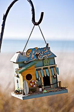 Hanging beach shop birdfeeder at beachfront holiday home, Anna Maria Island, Florida