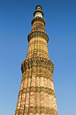Qutub Minar minaret tower with verses from the Qur'an at Qutab Minar Complex, Unesco World Heritage Site in New Delhi, India