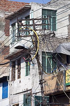Electricity pylon at Khari Baoli, Old Delhi, India