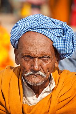 Hindu pilgrim with turban at Dashashwamedh Ghat in holy city of Varanasi, Benares, India
