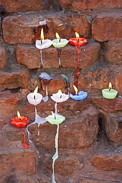 Lighted candles offering Buddhist prayers at Dharmarajika Stupa at Sarnath near Varanasi, Northern India
