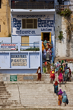 Indian women queue for silk shop near Chet Singh Ghat on banks of The Ganges River in holy city of Varanasi, Northern India