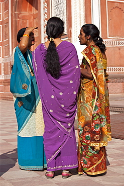 Indian women at South Gate of The Taj Mahal, Darwaza-i rauza in Uttar Pradesh, India