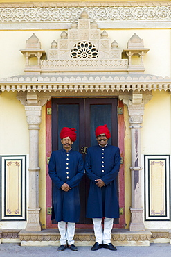 Palace guards in achkan suit at former Royal Guest House now a textile museum in the Maharaja's Moon Palace in Jaipur, Rajasthan, India