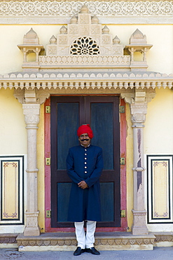 Palace guard in achkan suit at former Royal Guest House now a textile museum in the Maharaja's Moon Palace in Jaipur, Rajasthan, India