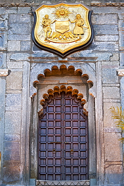 Ornate gateway and plaque of The City Palace Complex of the 76th Maharana of Mewar, Shriji Arvind Singh Mewar of Udaipur, Rajasthan, India