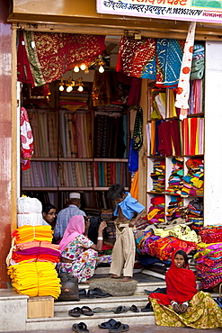 Indian family shopping for children's clothes in old town in Udaipur, Rajasthan, Western India