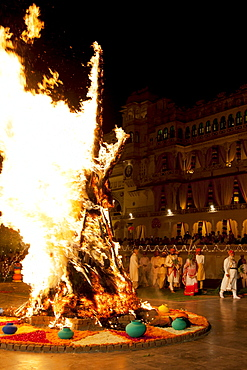 Shriji Arvind Singh Mewar of Udaipur, 76th Custodian of the House of Mewar, presides at annual Hindu Holi Fire Festival at The Zenana Mahal in the City Palace, Udaipur, Rajasthan, India. With him is wife  Maharani Vijaya Laxmi and son  and heir Lakshyaraj Singh Mewar of Udaipur, Maharaj Kumar