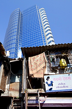 Essar House office development for Essar Group by slums in Mahalaxmi area of Mumbai, India shows contrast of rich and poor