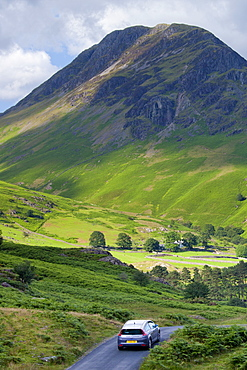 Motorist touring by Wasdale Fell and Wastwater in the Lake District National Park, Cumbria, UK