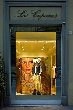 Shop window display of Les Copains fashion clothes shop at Hotel de la Ville in Piazza Degli Antinori, in Florence,Tuscany, Italy