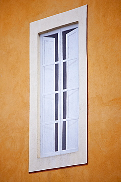 Trompe L'oeil painted effect of a window in Costa di Piazza Garibaldi in old hill town of Montalcino in Val D'Orcia, Tuscany, Italy