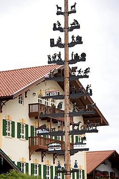 Maypole of rural pastoral and trades scenes at Grassau in Baden-Wurttenberg, Bavaria, Germany