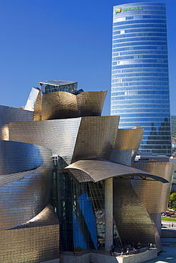 Frank Gehry's Guggenheim Museum futuristic architectural design in titanium and glass and Iberdrola Tower at Bilbao, Spain