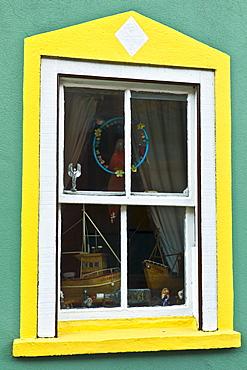 Aquamarine colour wall and yellow window border in Kinsale, County Cork, Ireland